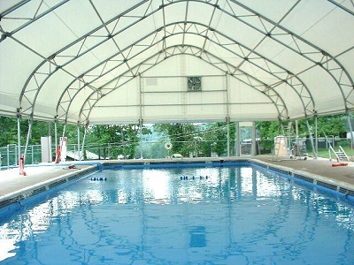 Tensioned membrane buildings are light and warm making them ideal for swimming pools