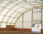 Tensioned membrane buildings can have arched roofs